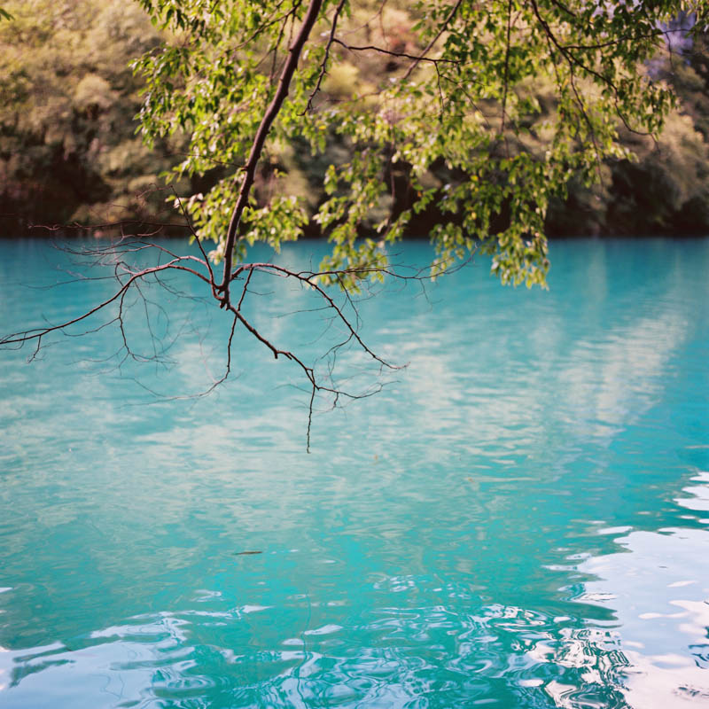 The turquoise blue waters of a lake in Plitvice, Croatia